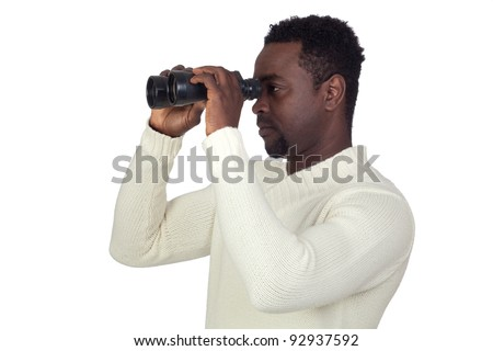 Attractive african man looking through binoculars isolated on a over white background - stock photo