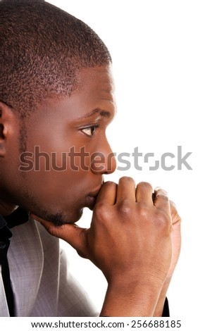 Attractive african man thinking about an idea - stock photo