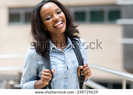 attractive african university student on campus - stock photo