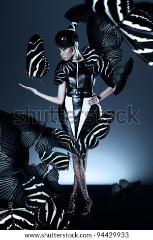 Attractive african woman with butterflies - stock photo