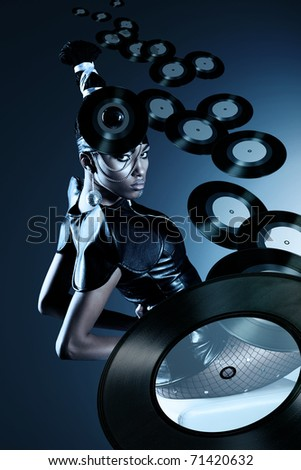Attractive african woman with flying records - stock photo