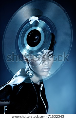 Attractive african woman with vinyl record on the head - stock photo