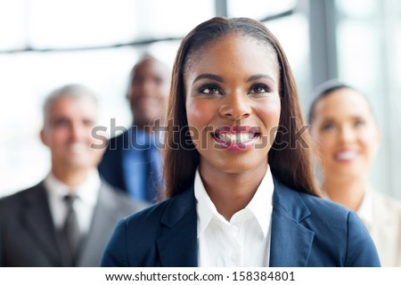 attractive afro american businesswoman and team looking up - stock photo
