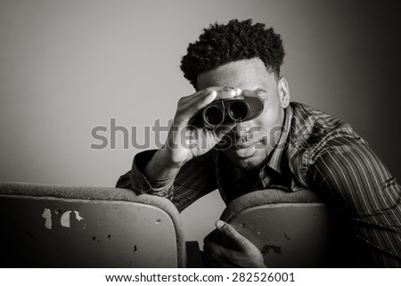 Attractive afro-american man posing in a  studio isolated on a background, black and white image