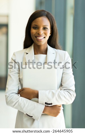 attractive afro american office worker holding laptop computer - stock photo