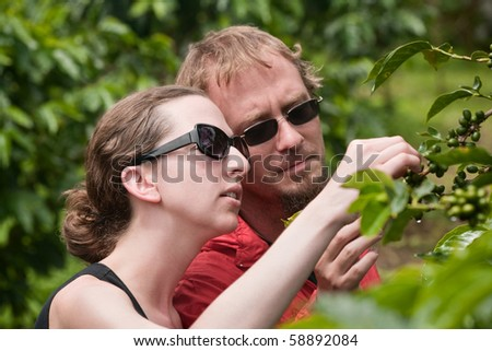 Attractive American and European couple on coffee plantation in Costa Rica - stock photo
