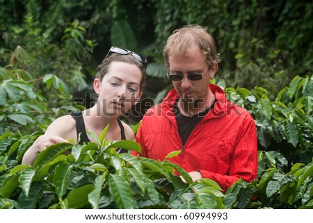 Attractive American and European couple on coffee plantation in Costa Rica