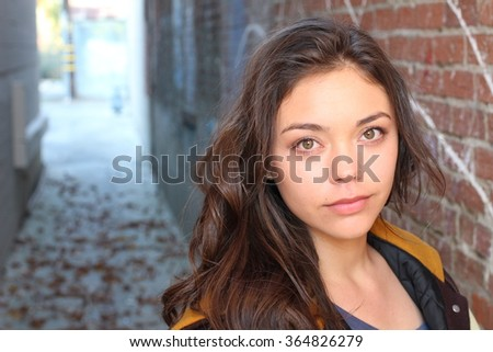 Attractive american student girl standing  - stock photo