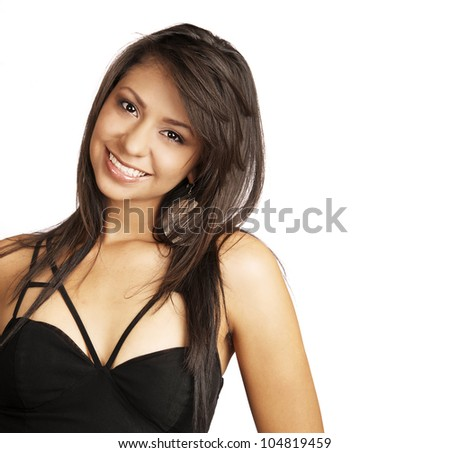 Attractive and beautiful young woman smiling in black dress isolated against white background.