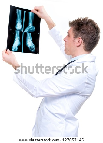 attractive and expressive cheerful doctor holding an foot x-ray - stock photo