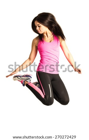 Attractive and sportive young woman - interesting Asian - Caucasian mix - jumping isolated on white background - stock photo