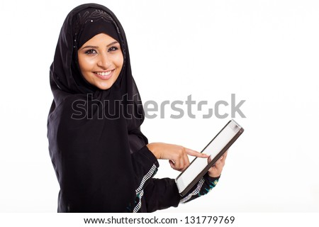 attractive Arabic woman using tablet computer isolated on white - stock photo