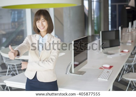 Attractive asian business woman cheerful on workplace