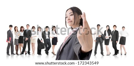 Attractive Asian business woman give you a fake sign and stand in front of her team. - stock photo