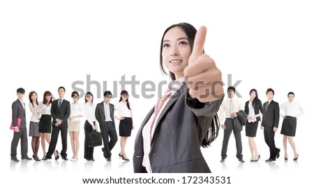 Attractive Asian business woman give you an excellent sign and stand in front of her team. - stock photo