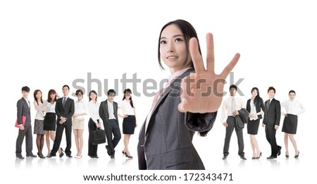 Attractive Asian business woman give you an okay sign and stand in front of her team. - stock photo