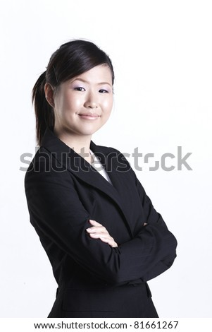 Attractive Asian business woman shot in studio - stock photo