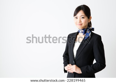 attractive asian businesswoman on white background - stock photo