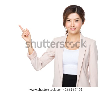 Attractive asian businesswoman showing finger point up - stock photo
