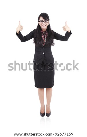 Attractive asian businesswoman showing two thumbs up on white background - stock photo