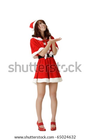 Attractive Asian Christmas woman standing and waiting snow falling isolated over white. - stock photo