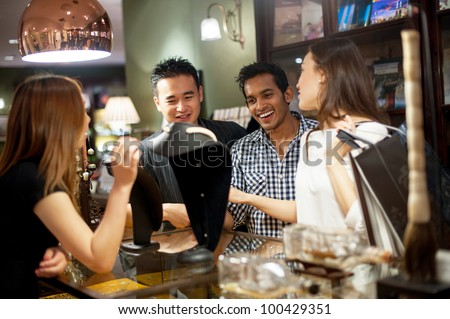 Attractive Asian Couple Shopping - stock photo