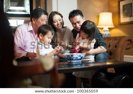 Attractive Asian Family in Lounge