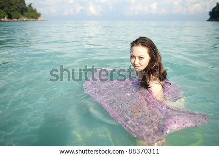 Attractive Asian Female in the ocean - stock photo