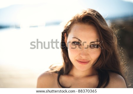 Attractive Asian Female looking at the camera - stock photo