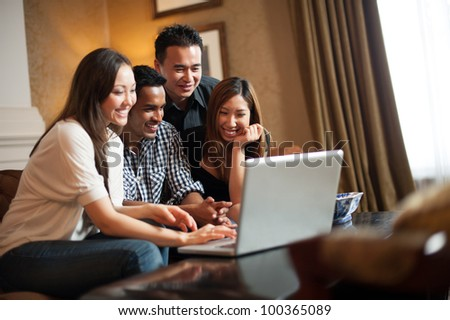 Attractive Asian Friends in Lounge - stock photo