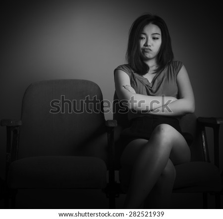 Attractive Asian girl in her 20s at the theatre isolate on a white background, black and white image
