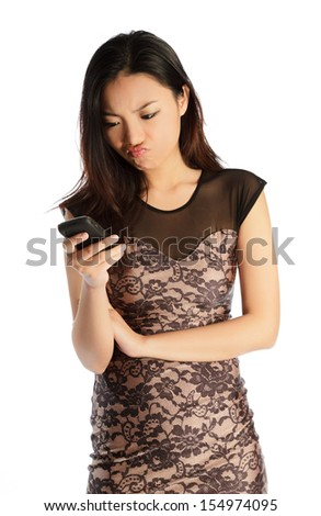 Attractive asian girl in her twenties isolated on a plein background shot in a studio - stock photo
