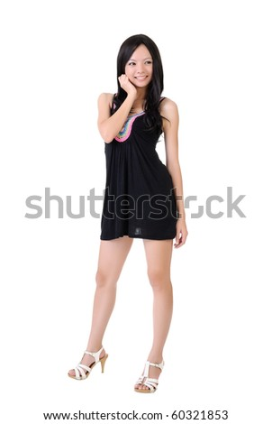 Attractive Asian girl posing and smiling, full length portrait isolated on white. - stock photo