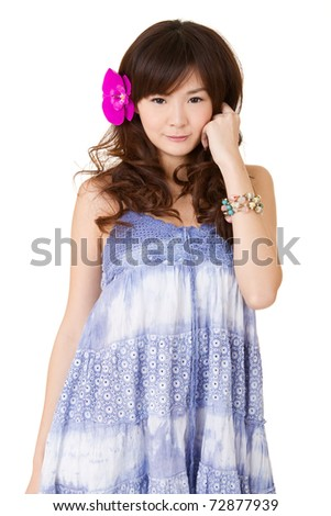 Attractive Asian girl with red flower on head, closeup portrait on white background. - stock photo