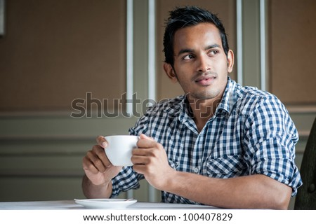 Attractive Asian Man in Cafe - stock photo