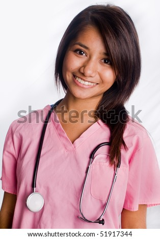Attractive Asian Nurse Standing with smile - stock photo