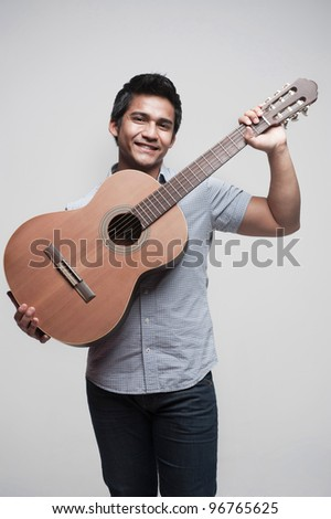 Attractive asian student with a musical instrument - stock photo