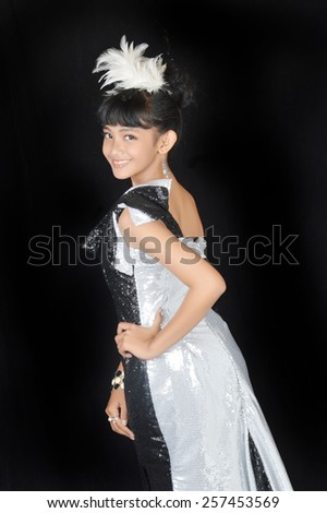 attractive asian teenage girl wearing glamour clothes on black background - stock photo