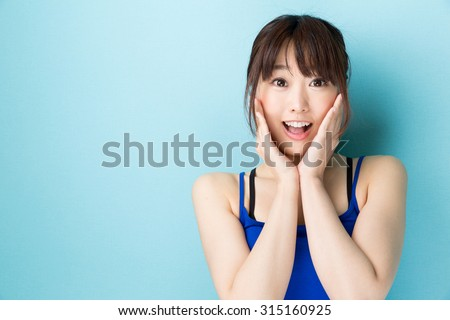 attractive asian woman beauty image isolated on blue background - stock photo