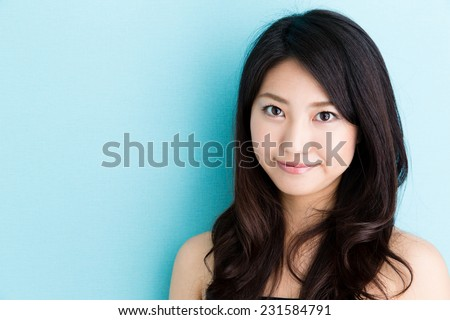 attractive asian woman beauty image on blue background - stock photo