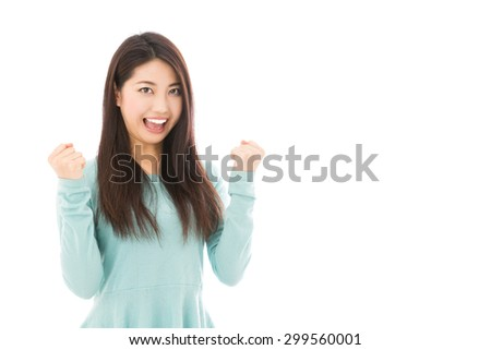 attractive asian woman cheering isolated on white background - stock photo