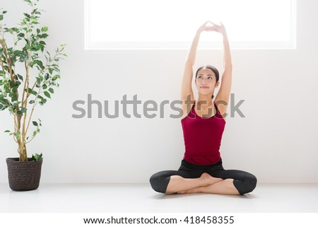 attractive asian woman exercising image - stock photo