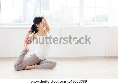 attractive asian woman exercising in the room - stock photo