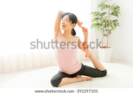 attractive asian woman exercising in the room