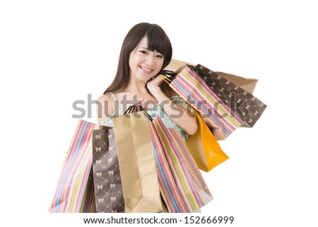 Attractive asian woman holding shopping bags, with exciting face. Portrait isolated on the white background.