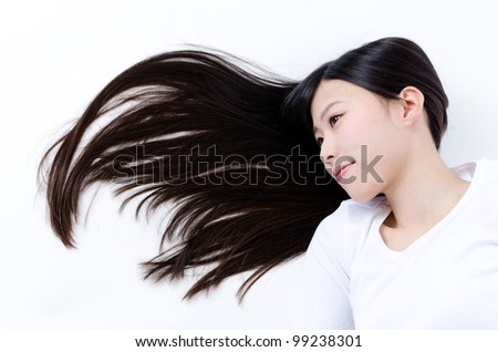 attractive asian woman lying with beautiful long hair - stock photo