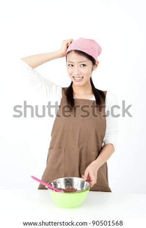 attractive asian woman making chocolate