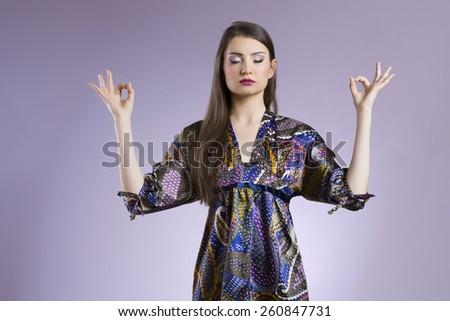 Attractive asian woman meditating - stock photo