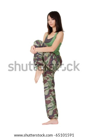 Attractive Asian woman of fitness doing stretch excise. - stock photo