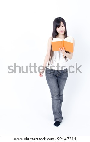 attractive asian woman reading a book isolated on white background - stock photo